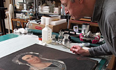 Ian Primrose working on restoration of oil painting in his Cape Cod, Mass. Studio